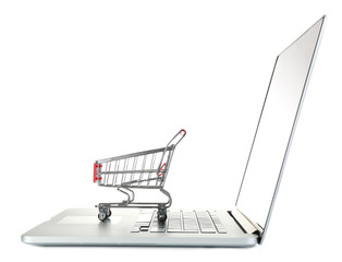 Laptop with small shopping cart isolated on white background