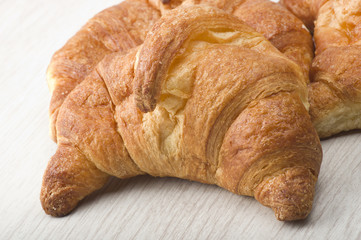 croissant close up on the gray wood table