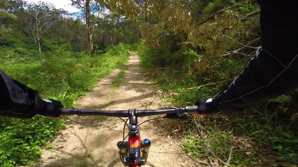 Mountain biking on a dirt road