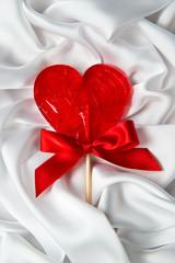 Lollipop heart on a gentle silk