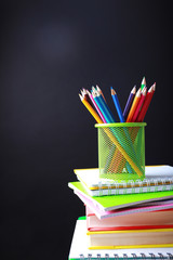 School supplies on black background