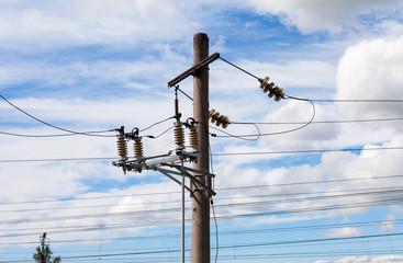 High voltage electricity pylon over cloudy sky