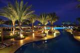 LuxuryTropical Resort Pool in dusk