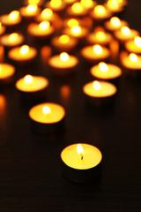 Burning candles on dark background