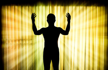 Silhouette man pray with light ray effect