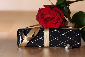 present box, red rose and ring for valentine's day