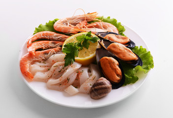 Tasty seafood on plate isolated on white