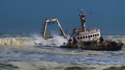 Shipwreck in waves Skeleton Coast Namibia Africa