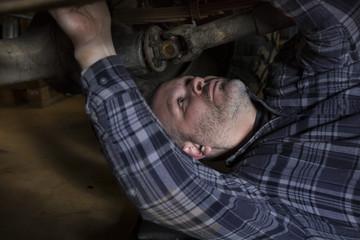 Man under car doing mechanic work