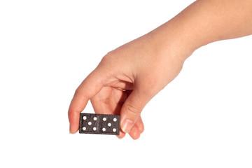 Hand holding black domino, isolated on white background.