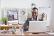 African businesswoman working with laptop