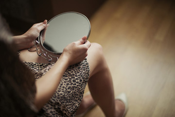 Girl holding a mirror in her hand