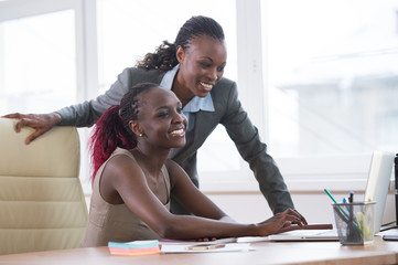 Business women in office working together