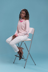 African woman sitting on a chair and thinking