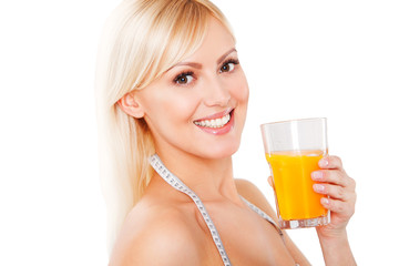 blond woman with the measuring tape drinking orange juice