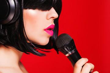 Closeup portrait of beautiful woman listening to music on