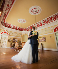 Bride and groom dancing the hall