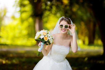beautiful bride with glasses smiling
