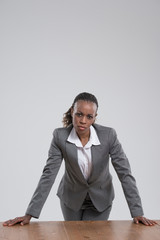 Pensive african business woman looking at camera