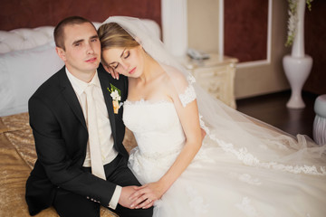 bride and groom sitting in the room
