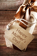 Happy Mothers Day message card on earth tone present box