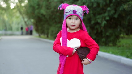 little girl in a knitted hat autumn owls with bag