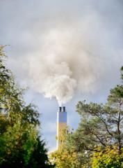 Heavy sunlit smoke and chimney