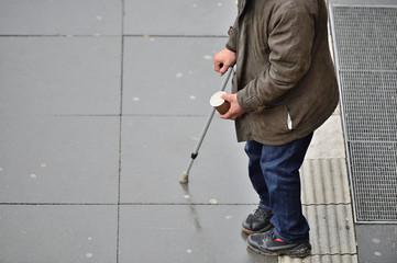 Beggar on sidewalk