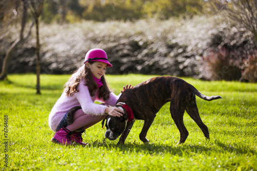 canvas print picture Child with a boxer dog