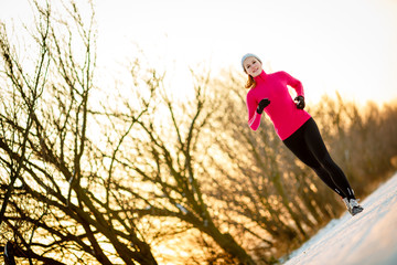Young woman running outdoors on a cold winter day