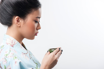 Tea ceremony conducted by Asian woman