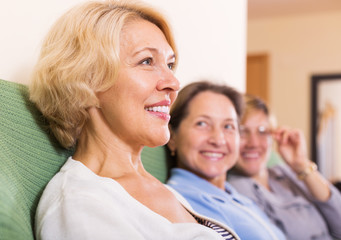 happy female pensioners at home
