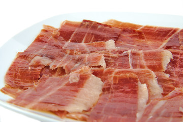Closeup of spanish serrano ham on white background.