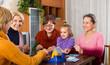Senior women with child at desk with bingo