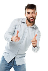 A young bearded man smiling with a fingers up isolated on white