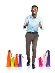 Happy african american man with shopping bags on white backgroun