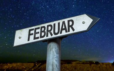 February (in German) sign with a beautiful night background