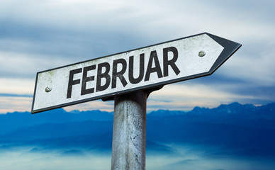 February (in German) sign with sky background