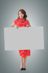 Chinese woman hold blank board