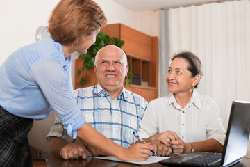Mature couple answer questions of outreach worker