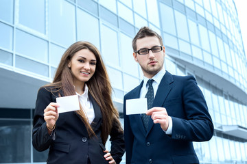 Successful young business people are holding a card,