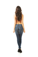 Back view of woman shirtless wearing jeans