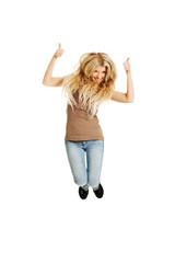 Young student jumping with thumbs up
