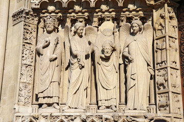 Statue of Saint Denis holding his head, Notre Dame cathedral