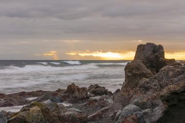 Sunrise on black sand volcanic beach. Tenerife