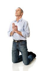 Man kneeling and praying to God