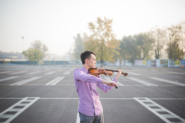 young crazy funny musician violinist asian man