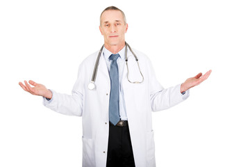 Mature male doctor holding copyspace