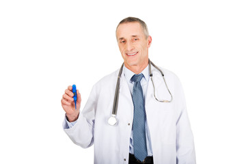 Mature male doctor holding a thermometer