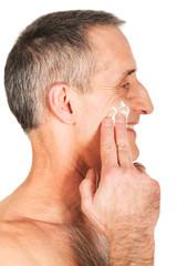 Man applying cream on his face